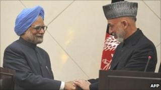 Manmohan Singh (left) with President Karzai
