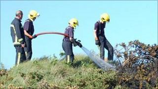 Firefighters tackle a gorse fire at Ladies Bay