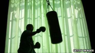 Man and punch-bag. Photo: Getty Images
