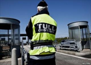 A Swedish customs officer stands at the Oeresund Bridge with Denmark, 6 May 2011