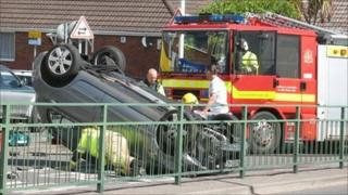 The scene of the crash with the Nissan Micra on its roof
