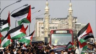 """Egyptians wave Palestinian flags during a """"Nakba"""" demonstration in front of the Israeli embassy in Cairo on 15 May 2011"""