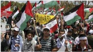 Palestinians protest at the Syrian border near the Israeli-controlled Golan Heights