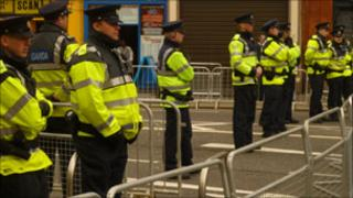 Irish police officers behind barriers