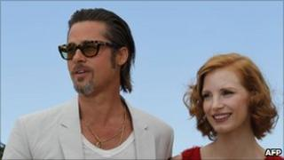 Brad Pitt and US actress Jessica Chastain pose during the photocall of The Tree of Life presented in competition at the 64th Cannes Film Festival