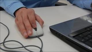 Man using a mouse and computer