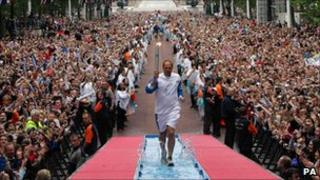 Olympic gold medallist Steve Redgrave carried the Olympic torch along the Mall before the Beijing Olympics
