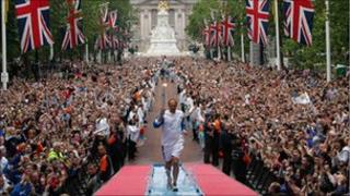 Steve Redgrave carrying the Olympic torch through London