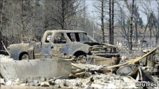 A burned out vehicle in Slave Lake in Alberta