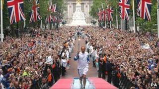 Sir Steve Redgrave carrying the Olympic torch in London (Photo: PA)