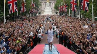 Olympic flame being carried by Steve Redgrave
