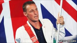 Danny Crates carrying the Great Britain flag at the 2008 Beijing Paralympics
