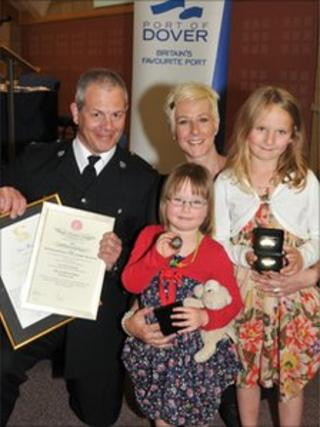Pc Ian Thwaites with Ria Hancock and her daughters, Ruby and Macy Rae