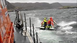 Lifeboat and fish farm boat. Pic: Lochinver RNLI/RNLI