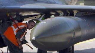 French military ground crew prepare a Rafale jet fighter for a mission to Libya, April 2011
