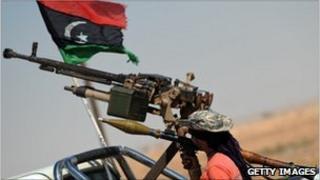 A Libyan rebel mans a checkpoint