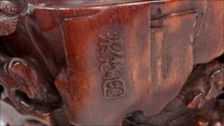 Close-up of stamp detail on rhino libation cup