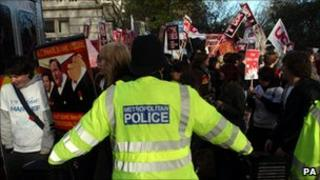 A police officer marshals students at a rally
