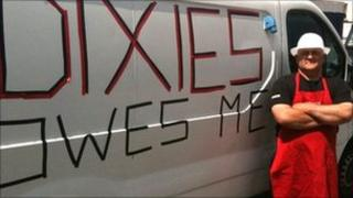 Andre Baudin with his van saying Dixies Owes Me