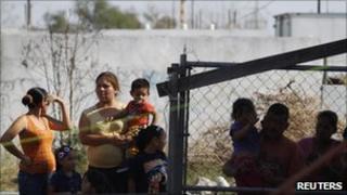 Relatives wait outside Mexico's Apodaca prison