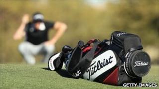 Titleist golf bag with golfer in background