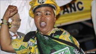 An ANC (African National Congress) supporter takes part in an election victory celebration in Johannesburg 20 May 2011