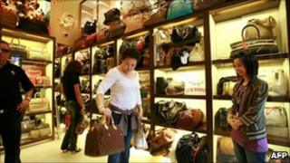 A shopper tries out a bag in a Milan Station store