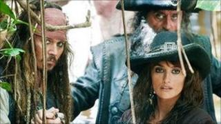 Johnny Depp with Ian McShane, back, and Penelope Cruz in Pirates of the Caribbean: On Stranger Tides