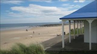 A beach house sits on shoreline