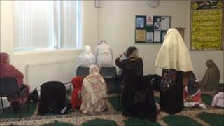 Muslim women at prayer in Madina mosque Manchester