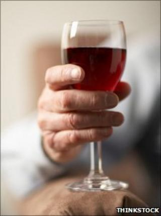 Elderly person with wine glass