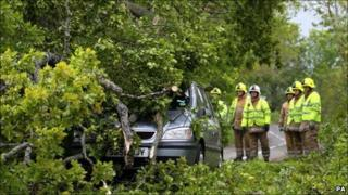 Emergency services tend to a car trapped by a fallen tree near Dunblane