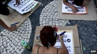Portuguese and Spanish youths prepare flyers at a protest in Rossio Square, Lisbon, 23 May 2011