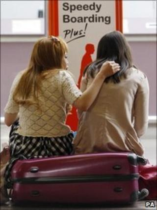 Passengers at Glasgow Airport in Scotland