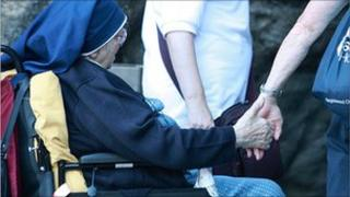 Nun with helper at Lourdes. Photo: Tom Simcox, Hexham and Newcastle