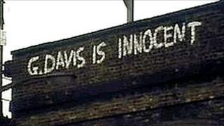 Motorway bridge with slogan about George Davis
