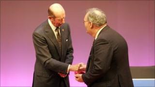 John Porter receiving his award from the Duke of Kent. Copyright: RNLI/Jon Stokes