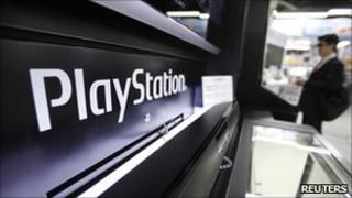 A man plays a game on Sony's PlayStation 3 game console