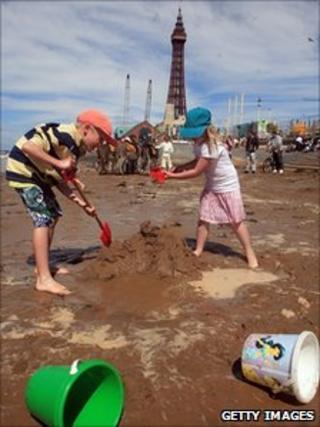 Children make sand castles on Blackpool beach