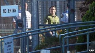 Former Guantanamo Bay inmate David Hicks (centre) walks to the exit at Adelaide's maximum security Yalata jail, 29 December 2007