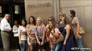Women pose in front of Tiffany store