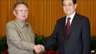 May 25, 2011 pic released by Xinhua, NK leader Kim Jong Il, left, shakes hands with Chinese President Hu Jintao