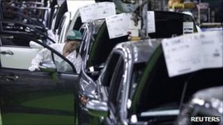 A worker assembles cars at Honda Motor's factory