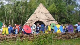 Children around the Iron Age Roundhouse