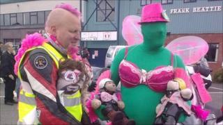 Bikers wearing pink bras
