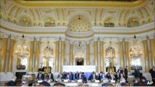 Presidents of 20 East and Central European countries attend a plenary session at the Royal Castle in Warsaw, Poland, Friday, May 27, 2011