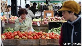 Picture of a man at a fruit stall in a New York farmers market