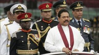 President Rajapaksa (wearing a scarf) inspects a guard of honour at the military festival