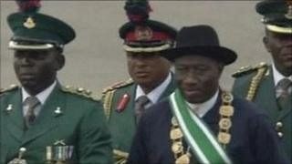 Goodluck Jonathan inspects a military parade during his inauguration ceremony