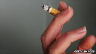 A hand holding a cigarette